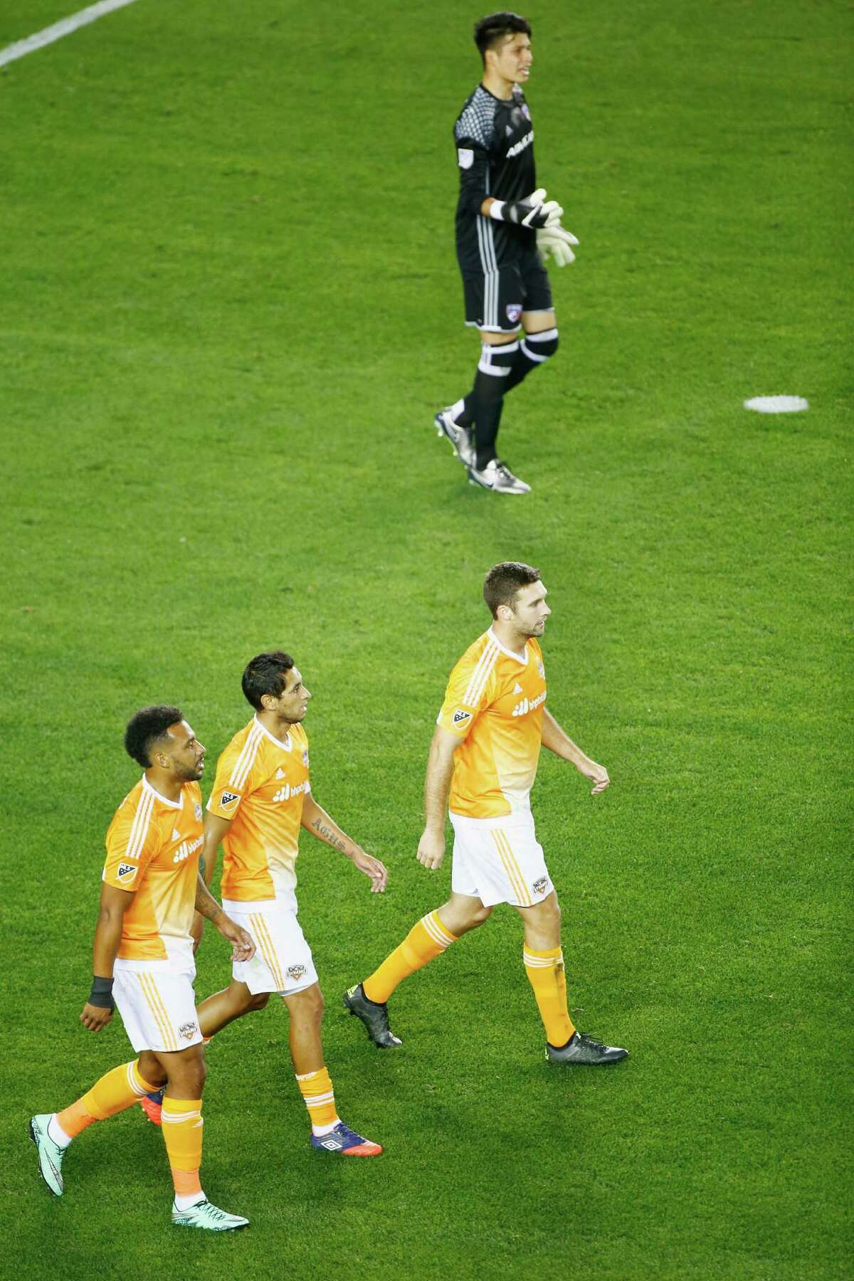 HOUSTON, TX - MARCH 12: Members of the Houston Dynamo celebrate a first-half own goal past Jesse Gonzalez #1 of FC Dallas during their game at BBVA Compass Stadium on March 12, 2016 in Houston, Texas.