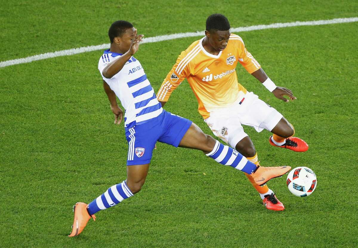 HOUSTON, TX - MARCH 12: Fabian Castillo #11 of FC Dallas battles for the ball with Jalil Anibaba #2 of the Houston Dynamo during their game at BBVA Compass Stadium on March 12, 2016 in Houston, Texas.