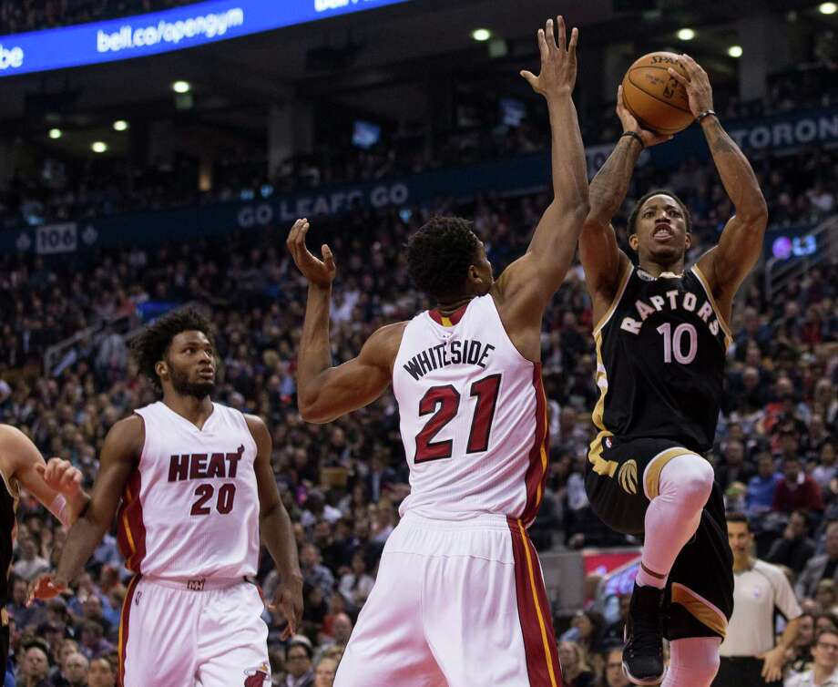 Toronto Raptors' DeMar DeRozan, right, shoots on Miami Heat's Hassan Whiteside during the first half of an NBA basketball game in Toronto on Saturday, March 12, 2016. (Chris Young/The Canadian Press via AP) MANDATORY CREDIT ORG XMIT: CHY106 Photo: Chris Young / The Canadian Press