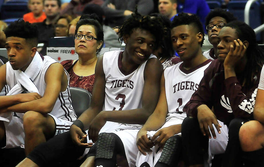 Silsbee's Devon McCain (left) was taken off on a stretcher after accidentally being struck in the head by a teammate's elbow and hitting his head on the court. Photo: Kim Brent, Kim Brent/The Enterprise / Beaumont Enterprise