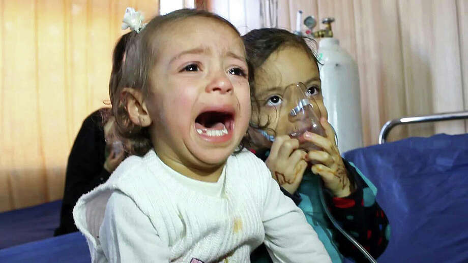 In this Friday, March 11, 2016 photo, young victims exposed to a chemical attack wait for treatment at a hospital in Taza, 10 miles (20 kilometers) south of Kirkuk in northern Iraq. The Islamic State group launched two chemical attacks near the northern Iraqi city of Kirkuk, killing a three-year-old girl, wounding some 600 people and causing hundreds more to flee, Iraqi officials said Saturday. (AP Photo) ORG XMIT: BAG103 Photo: Uncredited / AP