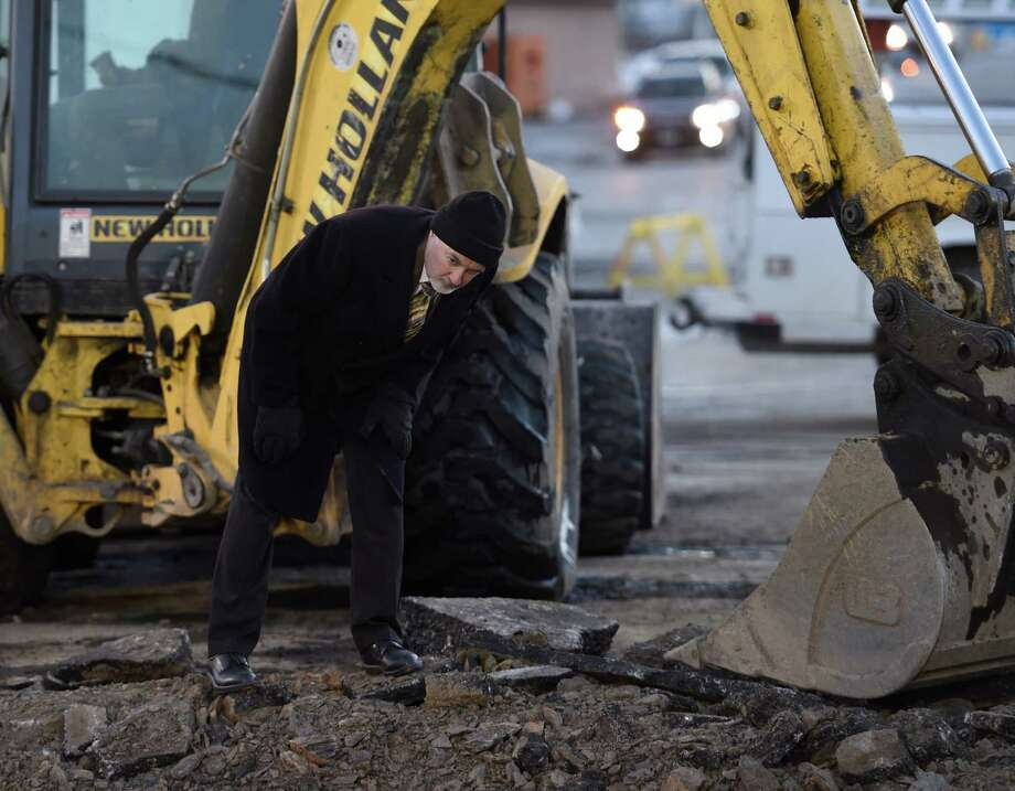 Troy Mayor Patrick Madden checks out the progress of the repair of the 33 inch main at 125th Street and Fifth Avenue early Wednesday morning, Jan. 20, 2016, in Troy, N.Y. The water main caused major problems to municipalities that buy water from Troy. (Skip Dickstein/Times Union) Photo: SKIP DICKSTEIN / 10035076A