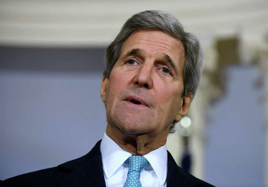 """FIL - In this March 9, 2016, file photo, Secretary of State John Kerry speaks to reporters at the State Department in Washington. The Obama administration is nearing a decision on whether to formally declare that Islamic State group atrocities against religious minorities, including Christians, constitute """"genocide."""" Kerry is leaning toward making the determination and could do so as early as next week, when a congressional deadline for action has been set, according to several administration officials. (AP Photo/Susan Walsh, File) ORG XMIT: WX105 Photo: Susan Walsh / AP"""