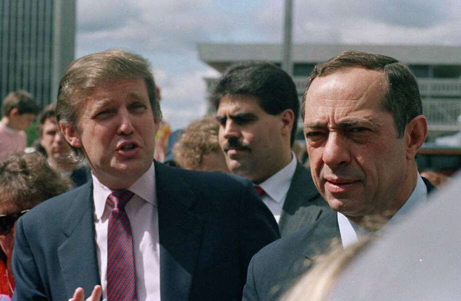 Developer Donald Trump and New York State Gov. Mario Cuomo get together before the start of the Tour De Trump bicycle race in Albany, New York on May 6, 1989. (AP Photo/Alan Soloman) Photo: Alan Soloman / AP1989