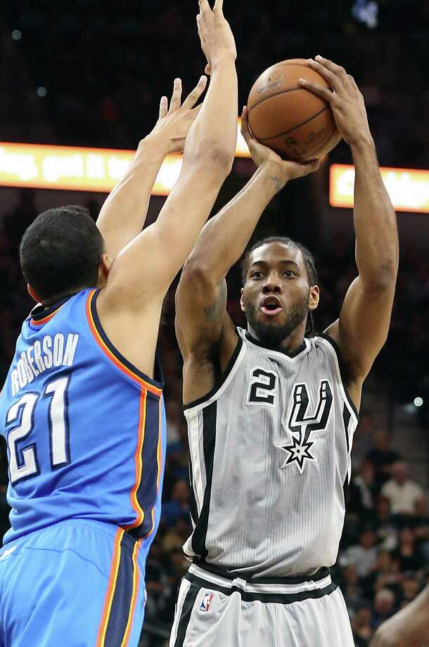 Kawhi Leonard puts up a shot over Andre Roberson as the Spurs host the Thunder at the AT&T Center  on March 12, 2016. Photo: TOM REEL, STAFF / SAN ANTONIO EXPRESS-NEWS / 2016 SAN ANTONIO EXPRESS-NEWS