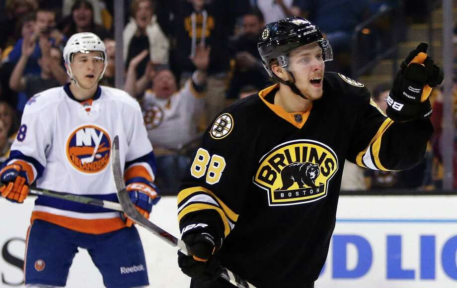 Boston Bruins' David Pastrnak (88) celebrates his goal in front of New York Islanders' Ryan Strome (18) during the second period of an NHL hockey game in Boston, Saturday, March 12, 2016. The Bruins won 3-1. (AP Photo/Michael Dwyer) ORG XMIT: MAMD106 Photo: Michael Dwyer / Copyright 2016 The Associated Press. All rights reserved. This m