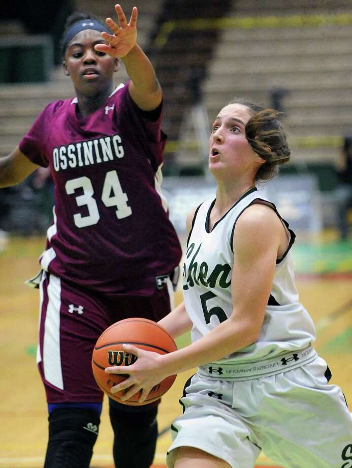 Shen's #5 , Cameron Tooley, right , goes to the basket guarded by Ossining's #34 Kailah Harris during their Class AA Championship game Saturday March 12, 2016 in Troy, NY.  (John Carl D'Annibale / Times Union) Photo: John Carl D'Annibale / 10035775A