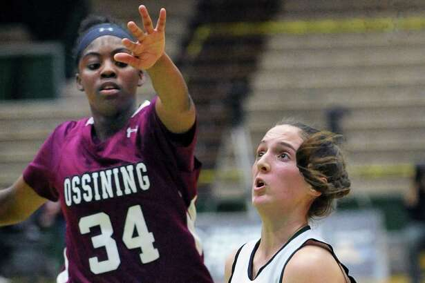 Shen's #5 , Cameron Tooley, right , goes to the basket guarded by Ossining's #34 Kailah Harris during their Class AA Championship game Saturday March 12, 2016 in Troy, NY.  (John Carl D'Annibale / Times Union)