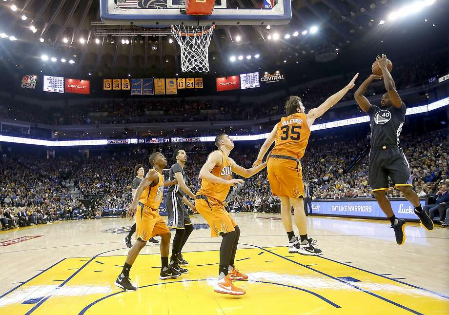 Golden State Warriors forward Harrison Barnes, right, puts up a shot over Phoenix Suns forward Mirza Teletovic (35) during the first half NBA game at Oracle Arena in Oakland, Calif., on Saturday, March 12, 2016. Photo: Tony Avelar, Special To The Chronicle