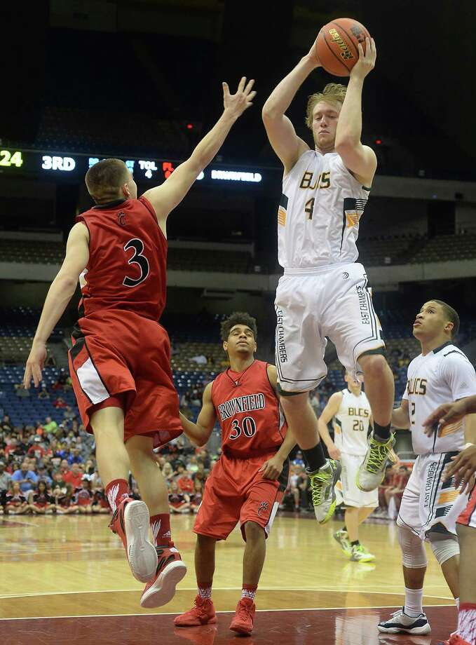 East Chambers' Dylan Silcox snags the rebound against Brownfield's Coby Serbantez during Saturday's Class 3A state final championship game at the Alamodome. Photo taken Saturday, March 12, 2016 Kim Brent/The Enterprise Photo: Kim Brent / Beaumont Enterprise