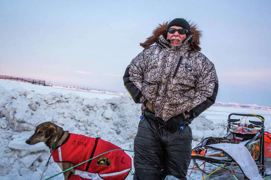 FILE - In this March 15, 2015 file photo, Jeff King is photographed  after arriving at the Unalakleet, Alaska. checkpoint in the Iditarod.  A person on a snowmobile drove into two dog teams competing in the Iditarod Trail Sled Dog Race early Saturday March 12, 2016, killing one dog and injuring at least three others. Mushers Aliy Zirkle  and Jeff King were attacked outside the village of, a community of 236 on the Yukon River a little more than halfway into the 1,000-mile (1,600-kilometer) race to Nome. (Loren Holmes/Alaska Dispatch News via AP)    ORG XMIT: AKAND201 Photo: Loren Holmes / Alaska Dispatch News