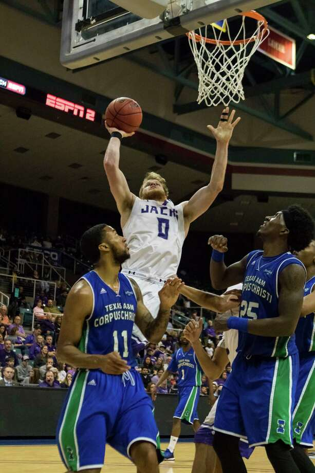 Stephen F. Austin Lumberjacks guard Thomas Walkup (0) puts a shot up after an offensive rebound in the second half of the Southland Conference mens basketball championship game at the Merrell Center on Friday, March 12, 2016, in Katy, TX. Photo: Joe Buvid, For The Chronicle / © 2015 Joe Buvid