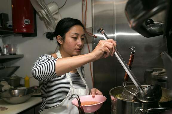 Nite Yun scoops broth into a bowl for the Kuy Tio Phnom Penh at Nyum Bai Cambodian pop-up hosted at Gashead Tavern in S.F.