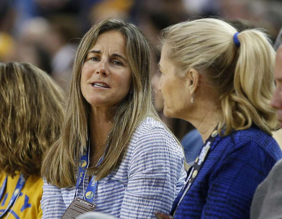 Former soccer player Brandi Chastain, left, looks on from the sidle seats as the Golden State Warriors played Phoenix Suns during the second half NBA game at Oracle Arena in Oakland, Calif., on Saturday, March 12, 2016. Photo: Tony Avelar, Special To The Chronicle