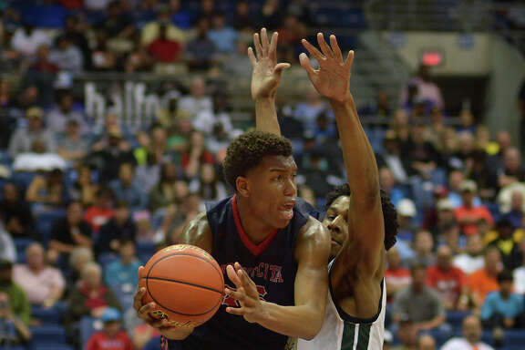 Atascocita junior forward Fabian White, left, battles for a shot against Desoto senior center Marques Bolden late in the 4th quarter of their Class 6A boys basketball state championship game at the Alamodome in San Antonio on Saturday, Mar. 12, 2016. (Photo by Jerry Baker/Freelance)