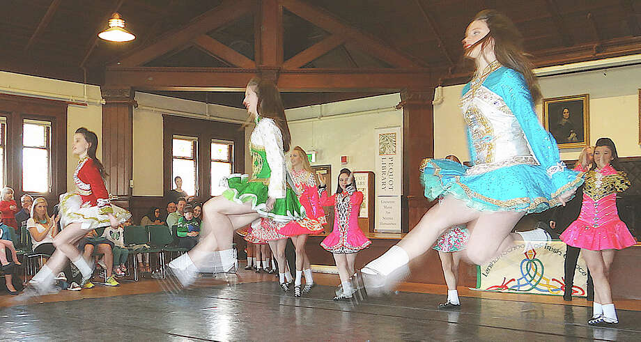 High-flying dancers from the Lenihan School of Irish Dance perform traditional Irish dances at the Pequot Library -- a Saturday prelude to St. Patrick's Day. Photo: Fairfield Citizen / Mike Lauterborn / Fairfield Citizen