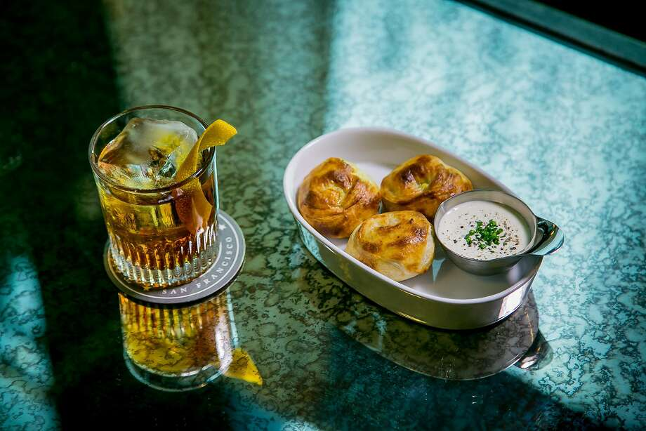 The Bamboozled cocktail with the Potato Puffs at the Treasury in San Francisco. Photo: John Storey, Special To The Chronicle