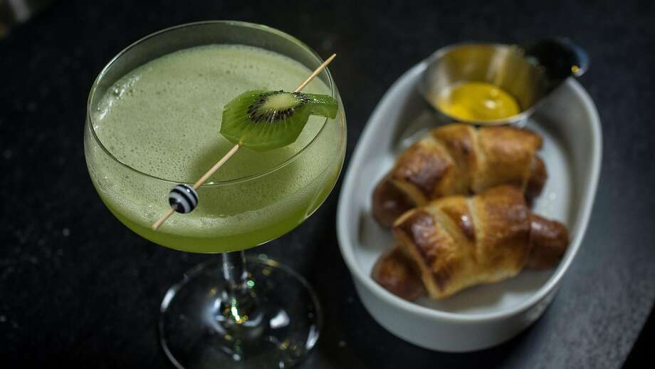 The Flash cocktail with Pigs in a Blanket at the Treasury. Photo: John Storey, Special To The Chronicle