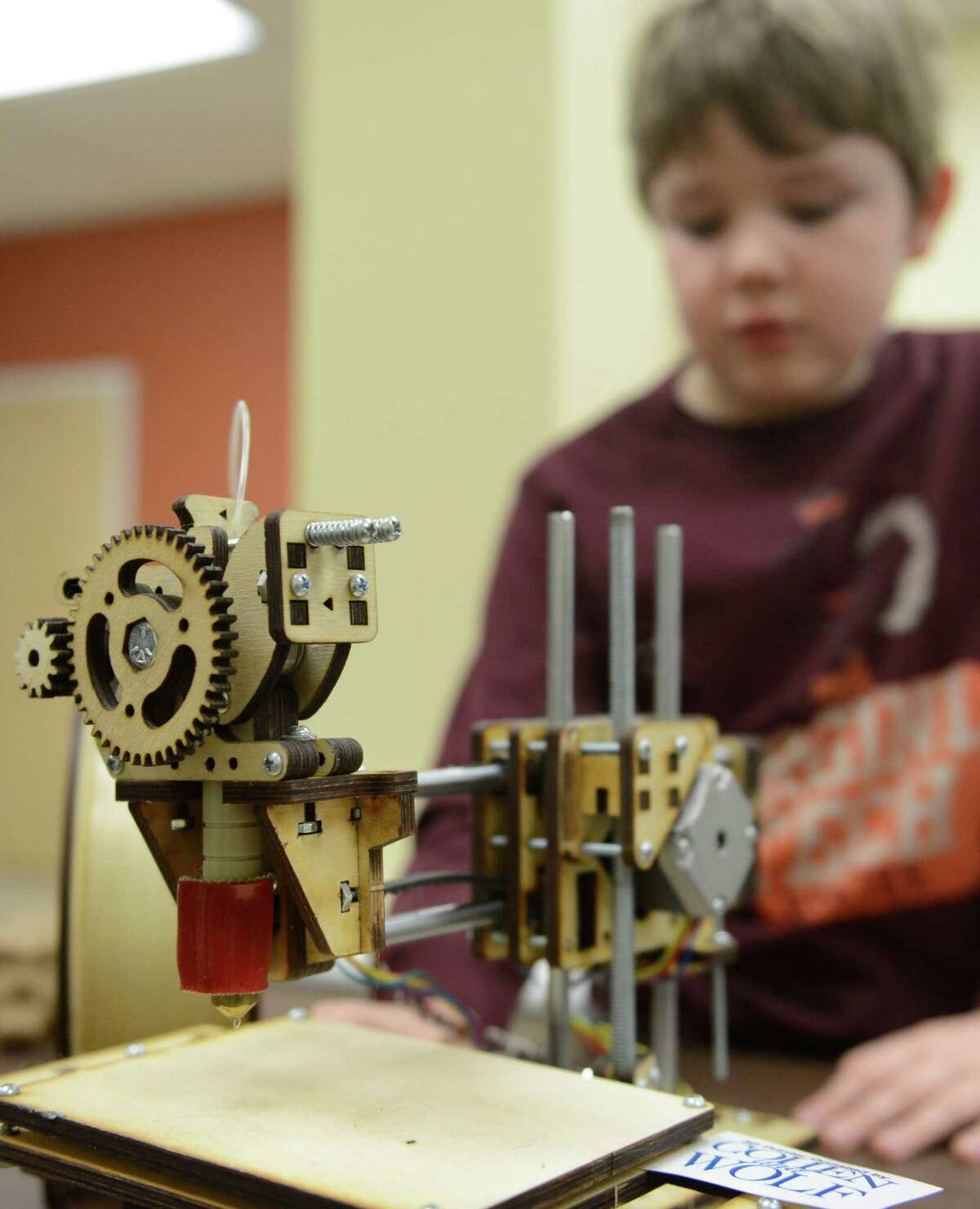 Leo Luning, a student at Hudson Country Montessori School, shows a model of the 3-D printer he assembled at the Danbury Innovation Center.