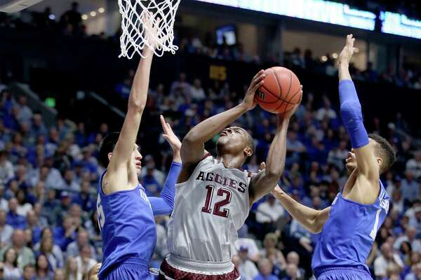 NASHVILLE, TN - MARCH 13:  Jalen Jones #12 of the Texas A&M Aggies shoots the ball against the Kentucky Wildcats during the Championship Game of the SEC Basketball Tournament at Bridgestone Arena on March 13, 2016 in Nashville, Tennessee.