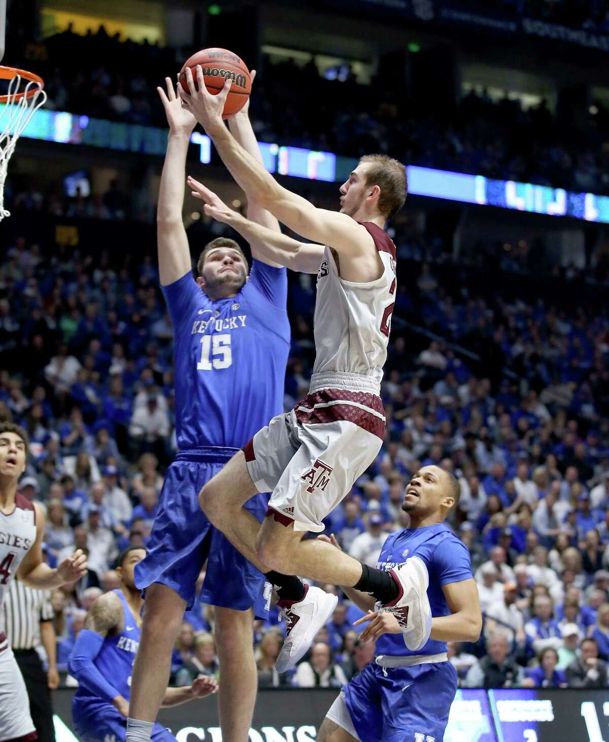 NASHVILLE, TN - MARCH 13: Alex Caruso #21 of the Texas A&M Aggies shoots the ball against the Kentucky Wildcats during the Championship Game of the SEC Basketball Tournament at Bridgestone Arena on March 13, 2016 in Nashville, Tennessee.