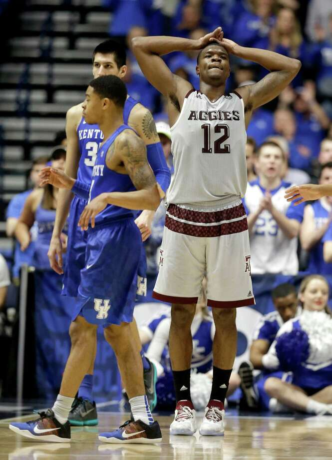 Texas A&M's Jalen Jones (12) reacts to being called for a foul against Kentucky during the second half of an NCAA college basketball game in the championship of the Southeastern Conference tournament in Nashville, Tenn., Sunday, March 13, 2016. Photo: Mark Humphrey, AP / AP