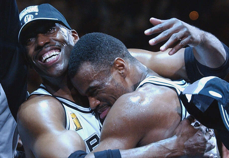 Kevin Willis gives David Robinson a hug during celebrations after winning Game 6 of the NBA Finals at the SBC Center in San Antonio on June 15, 2003. Photo: Kin Man Hui /San Antonio Express-News / SAN ANTONIO EXPRESS-NEWS
