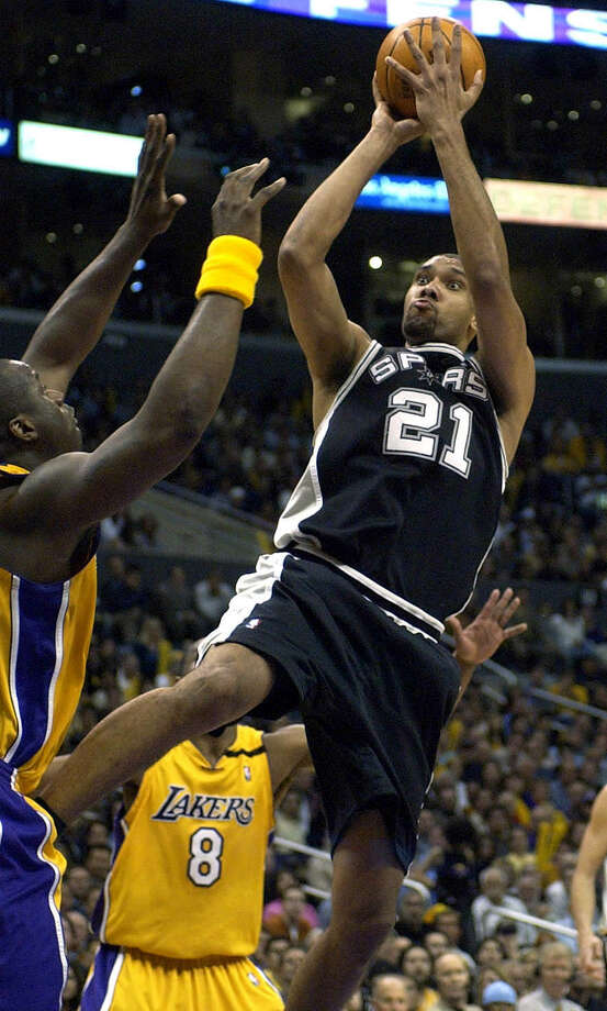 The Spurs' Tim Duncan shoots on May 15, 2003 at the Staples Center in Los Angeles over the Lakers' Shaquille O'Neal while Kobe Bryant stands in the background during Game 6 of the Western Conference semifinals. Photo: William Luther /San Antonio Express-News / SAN ANTONIO EXPRESS-NEWS