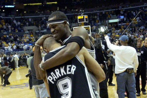 The Spurs' Tony Parker and Stephen Jackson celebrate May 15, 2003 at the Staples Center in Los Angeles after winning Game 6 of the Western Conference semifinals game against the Lakers 110-82.