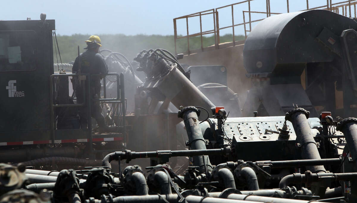Dust permeates the air at a Chesapeake Energy Co. fracking operation at a well site near Carrizo Springs, Texas in a 2011 file photo. The site is over the Eagle Ford shale formation where oil and gas is being extracted in the area.