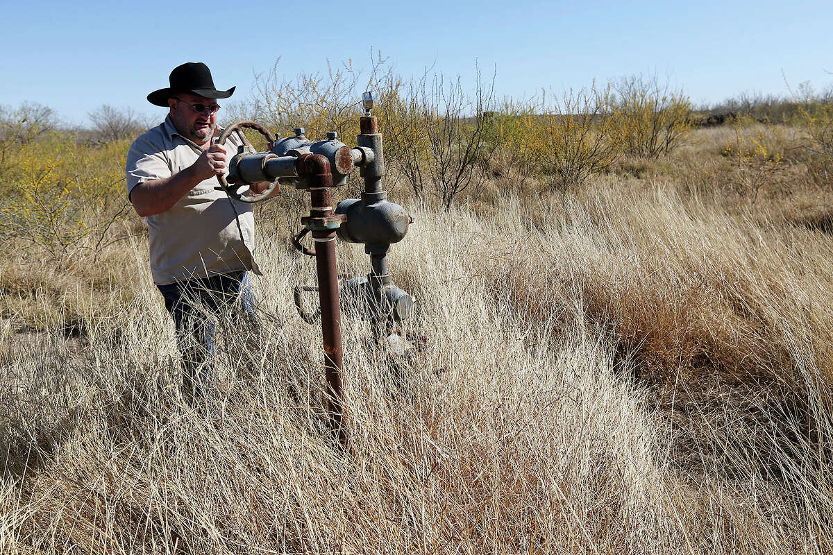 Tortuga Ranch owner David Holdsworth checks out the No. 3 well on his land in Zavala County in this 2013 file photo. The well was drilled by wildcatter Harvey Howell and produced natural gas but no money. Holdsworth's land sits on the edge of the Eagle Ford Shale play. He has contracted the deep mineral rights with a Chesapeake Energy Corp. but has reserved the shallow rights for Howell.
