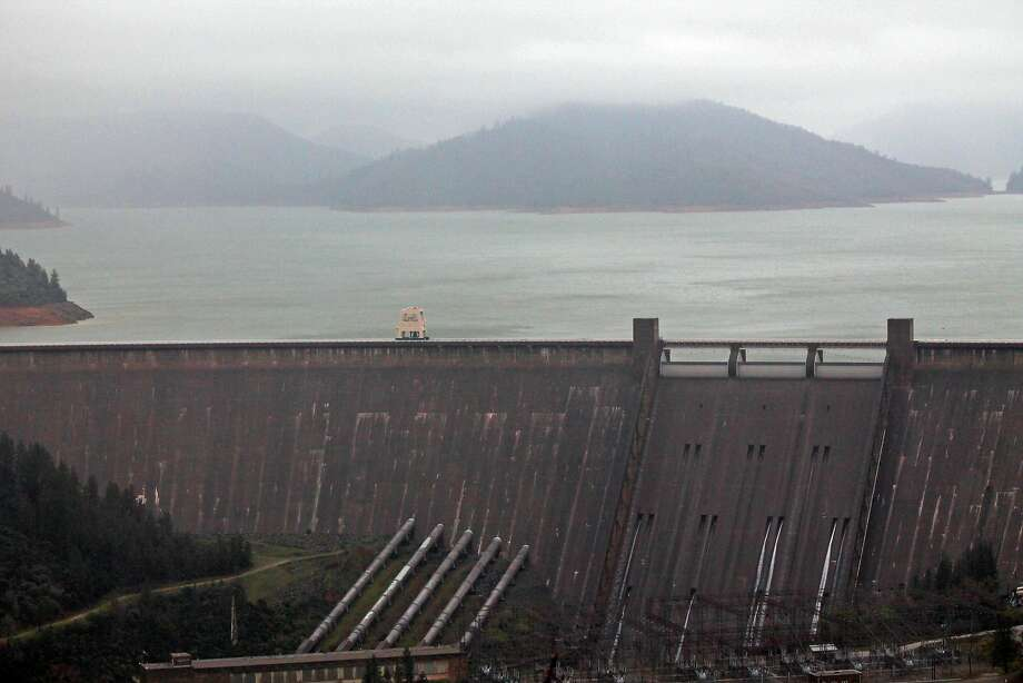Lake Shasta behind Shasta Dam in Lake Shasta, Calif., is seen Sunday, March 13, 2016. The lake's water level has been rising after a series of storms brought strong winds, periods of heavy rain, snow and high surf to California Sunday, the fourth straight day of wet weather. The lake is rising after several years of dropping water levels due to the ongoing California drought.(Nathan Solis/The Record Searchlight via AP) Photo: Nathan Solis, AP