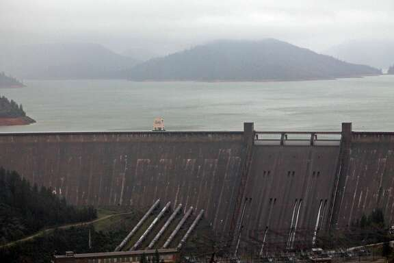 Lake Shasta behind Shasta Dam in Lake Shasta, Calif., is seen Sunday, March 13, 2016. The lake's water level has been rising after a series of storms brought strong winds, periods of heavy rain, snow and high surf to California Sunday, the fourth straight day of wet weather. The lake is rising after several years of dropping water levels due to the ongoing California drought.(Nathan Solis/The Record Searchlight via AP)