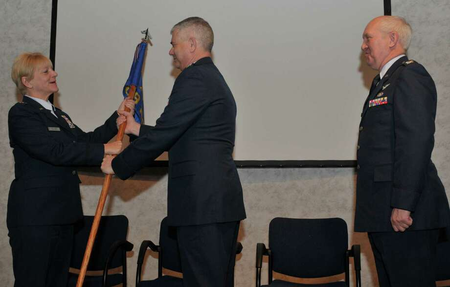Lt. Col. Janice Zaunter assumes command of the 109th Medical Group from Col. Shawn Clouthier, 109th Airlift Wing commander, during a ceremony here Feb. 7, 2016. Col. Douglas Cromack, outgoing commander, was the 109th MDG commander November 2014 through January 2016. (U.S. Air National Guard photo by Master Sgt. William Gizara/released) Photo: Msgt William Gizara / Digital