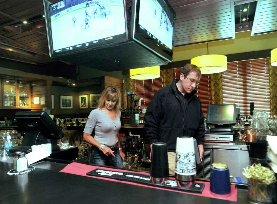 Karen Barbarie, owner of Barbarie's Black Angus Grille, accompanies  Ryan Boggan, as he inspects the bar area of the restaurant Monday, March 7, 2016. Photo: Carol Kaliff / Hearst Connecticut Media / The News-Times