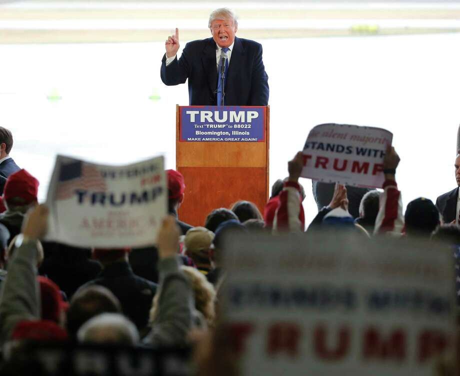 Republican presidential candidate Donald Trump addresses the crowd during a rally Sunday, March 13, 2016, in Bloomington, Ill. (AP Photo/Charles Rex Arbogast) ORG XMIT: ILCA121 Photo: Charles Rex Arbogast / Copyright 2016 The Associated Press. All rights reserved. This m