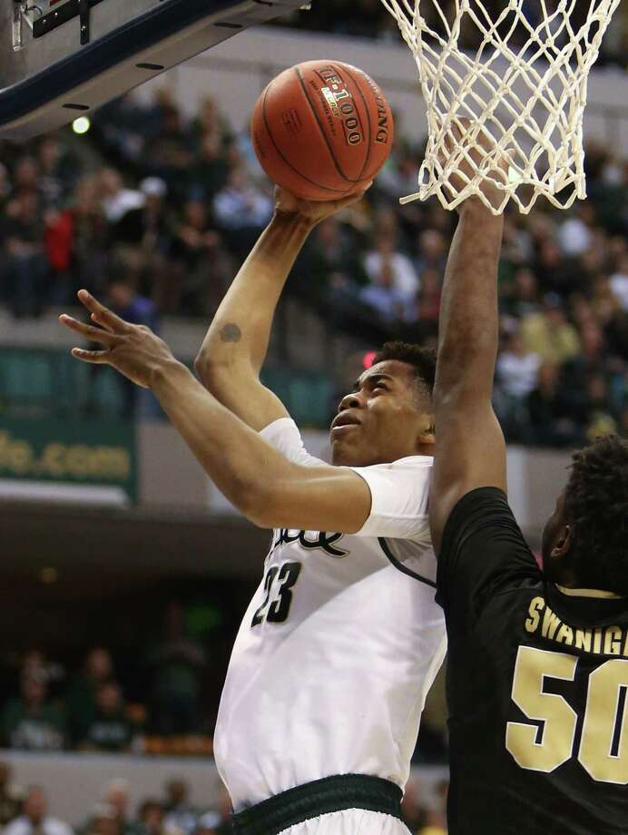 Michigan State's Denzel Valentine goes for a shot against Purdue's Caleb Swanigan during second half action in Indianapolis on Sunday, March 13, 2016. Michigan State won, 66-62. (Kirthmon F. Dozier/Detroit Free Press via AP) MANDATORY CREDIT ORG XMIT: MIDTF110 Photo: Kirthmon F. Dozier / Detroit Free Press