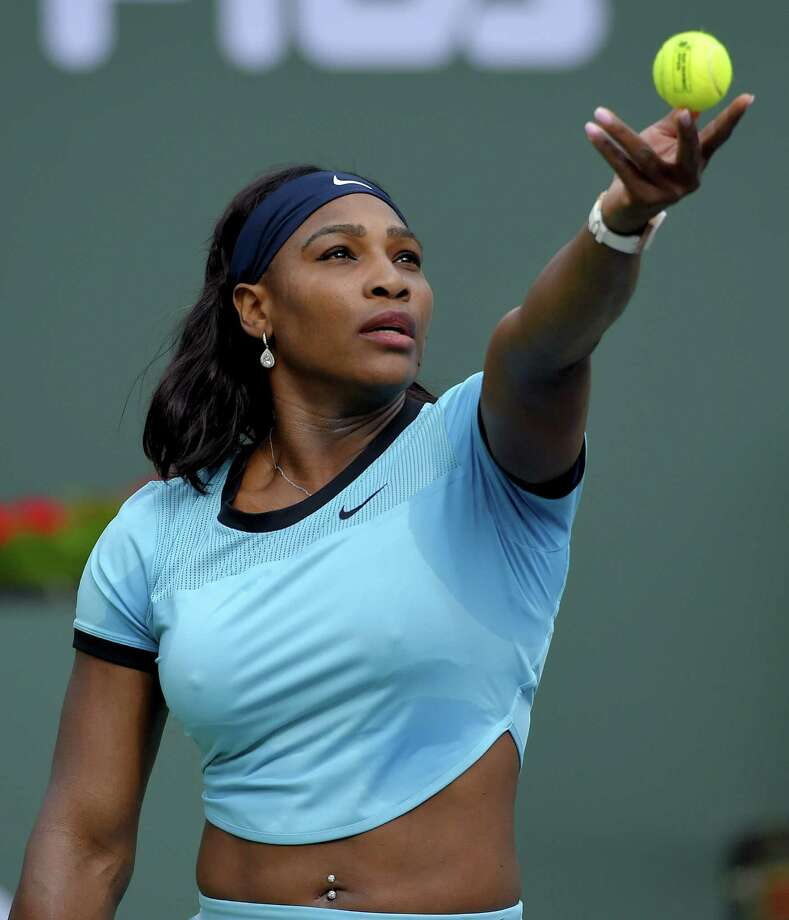 Serena Williams serves to Yulia Putintseva during their match at the BNP Paribas Open tennis tournament, Sunday, March 13, 2016, in Indian Wells, Calif. (AP Photo/Mark J. Terrill)  ORG XMIT: IWT136 Photo: Mark J. Terrill / AP