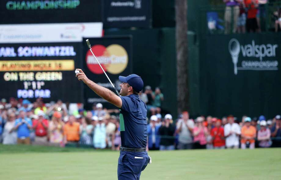 Charl Schwartzel, of South Africa, gestures to the crowd after sinking his putt to beat Bill Haas on a playoff of the 18th hole during the final round of the Valspar Championship golf tournament Sunday, March 13, 2016, in Palm Harbor, Fla. (AP Photo/Brian Blanco) ORG XMIT: FLBB125 Photo: Brian Blanco / FR170107 AP