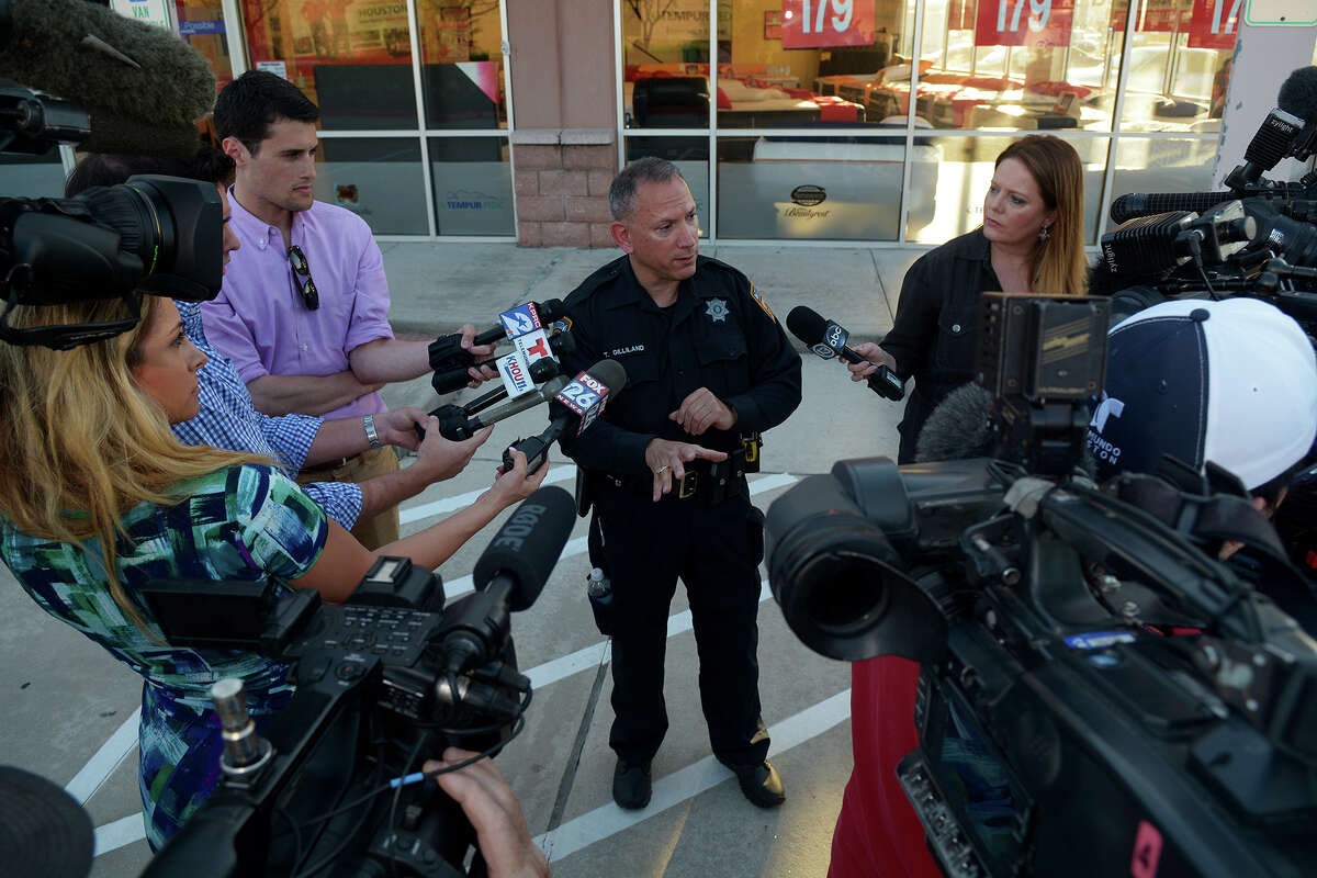 Harris County Sheriff's Office Spokesman Thomas Gilliland, center, briefs the media about a police shooting Sunday after a traffic stop.