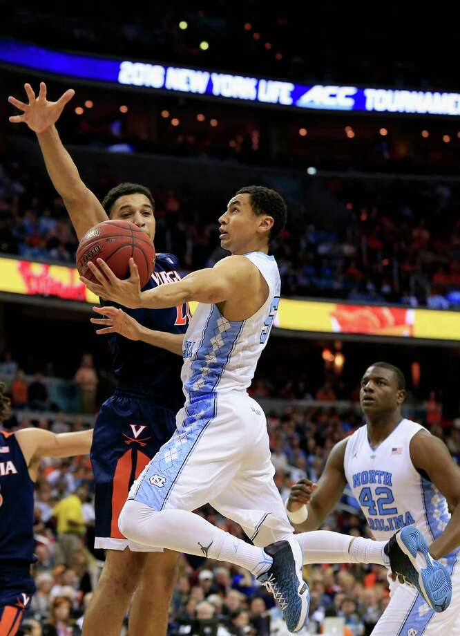 WASHINGTON, DC - MARCH 12: Marcus Paige #5 of the North Carolina Tar Heels puts up a shot in front of Isaiah Wilkins #21 of the Virginia Cavaliers in the second half during the finals of the 2016 ACC Basketball Tournament at Verizon Center on March 12, 2016 in Washington, DC.  (Photo by Rob Carr/Getty Images) ORG XMIT: 599971409 Photo: Rob Carr / 2016 Getty Images