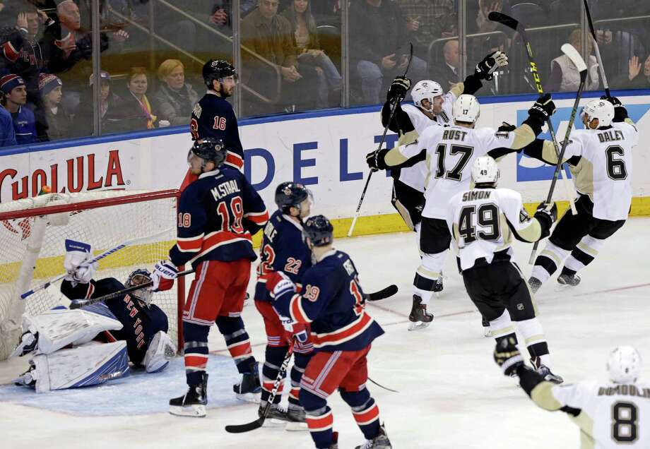Pittsburgh Penguins center Matt Cullen (7) celebrates with teammates after scoring a go-ahead goal past New York Rangers goalie Henrik Lundqvist (30) in the third period of an NHL hockey game, Sunday, March 13, 2016, in New York. (AP Photo/Adam Hunger) ORG XMIT: MSG109 Photo: Adam Hunger / FR110666 AP