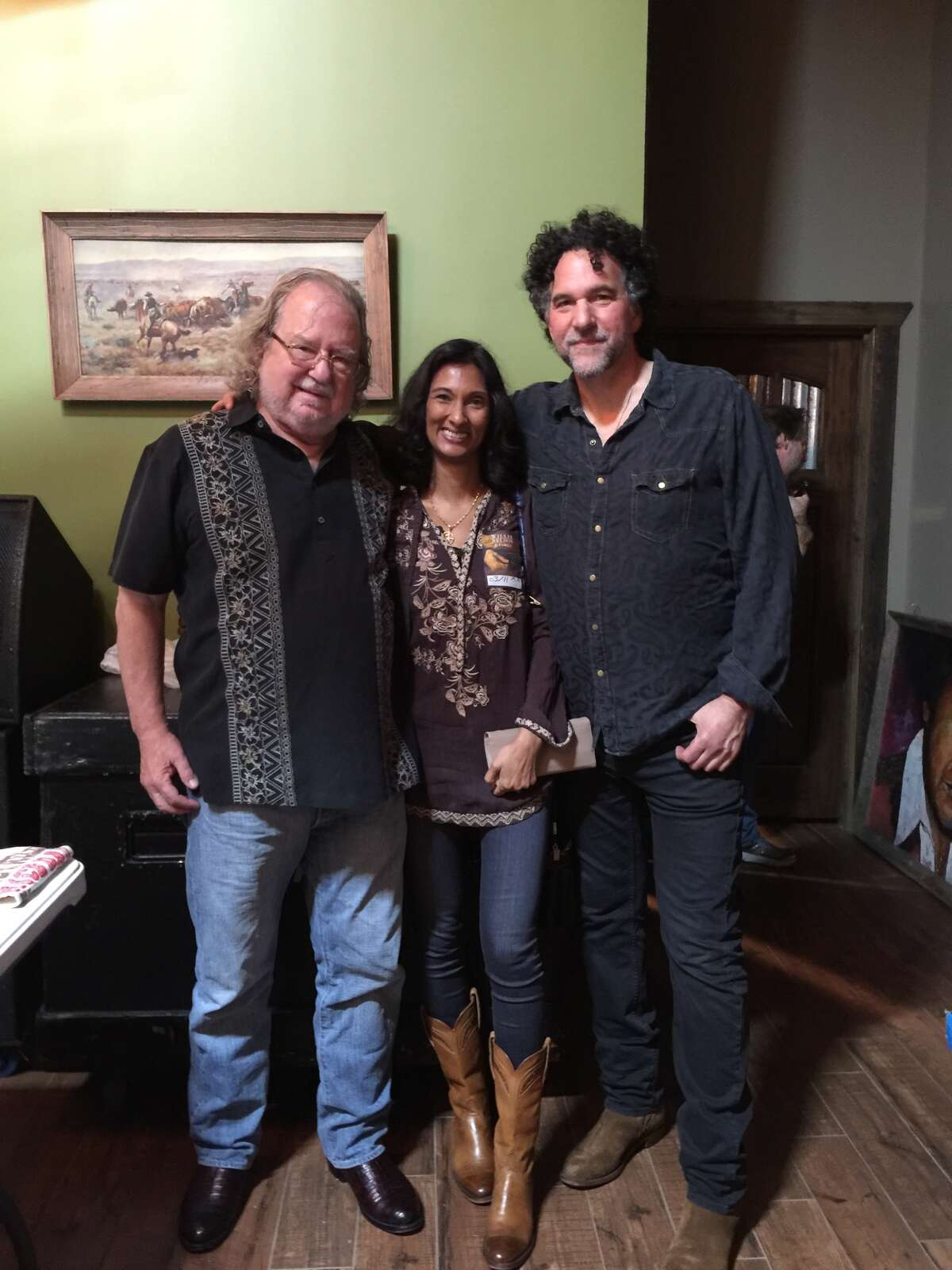 Immunologist James Allison (left) and wife, Dr. Padmanee Sharma, with Mickey Raphael, Willie Nelson's harmonica player.