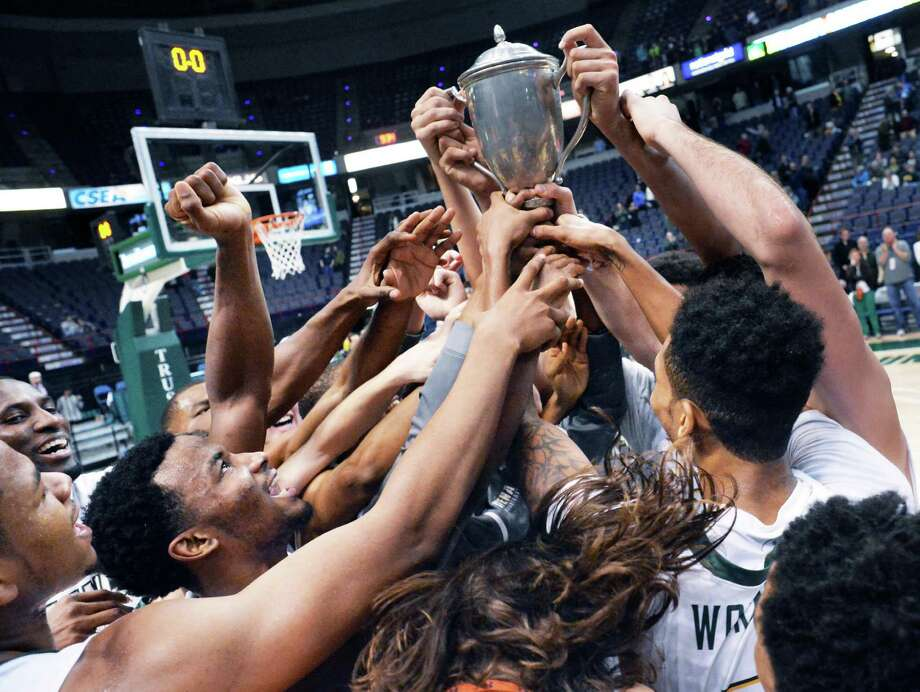 Siena players raise the Albany Cup high in celebration of their win over UAlbany Saturday at the Times Union Center Dec. 12, 2015 in Albany, NY.   (John Carl D'Annibale / Times Union) Photo: John Carl D'Annibale / 00034282A
