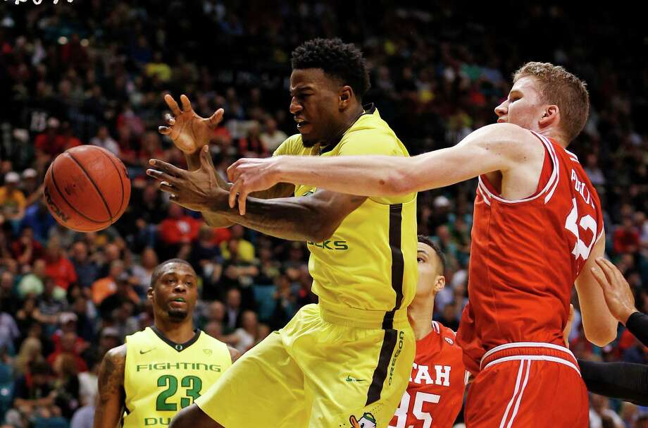 Oregon forward Jordan Bell, left, and Utah forward Jakob Poeltl battle for a rebound during the first half of an NCAA college basketball game in the championship of the Pac-12 men's tournament Saturday, March 12, 2016, in Las Vegas. Oregon won 88-57. (AP Photo/John Locher) ORG XMIT: NVJL131 Photo: John Locher / Copyright 2016 The Associated Press. All rights reserved. This m