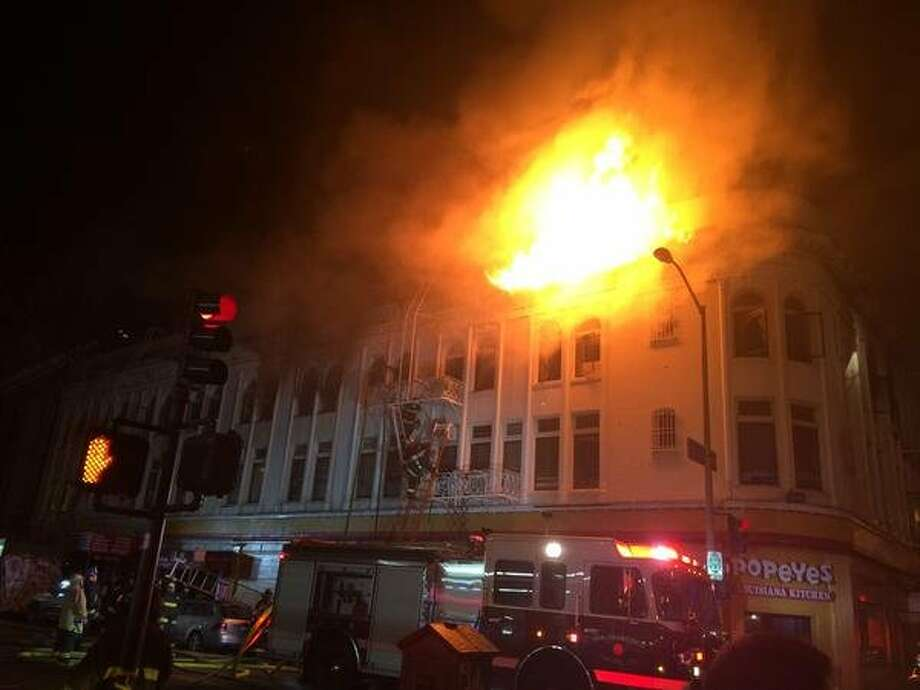 In this file photo, San Francisco firefighters battle a raging blaze on 22nd Street in the Mission District in San Francisco on Wednesday, Jan. 28, 2015. The same building caught fire late Sunday night and fire officials suspect it was started by squatters. Photo: Vivian Ho