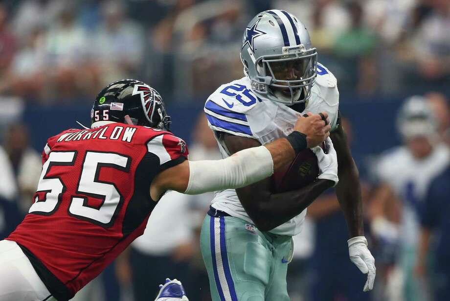 Lance Dunbar of the Dallas Cowboys runs the ball against  Paul Worrilow of the Atlanta Falcons at AT&T Stadium on September 27, 2015 in Arlington, Texas. Photo: Ronald Martinez, Getty Images / 2015 Getty Images