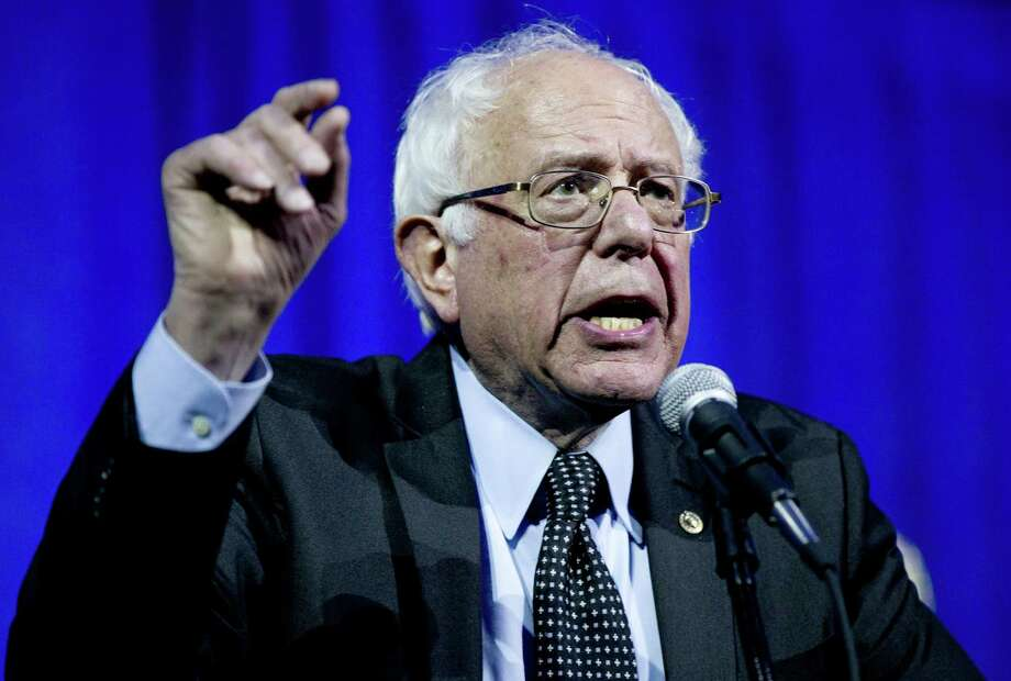 Democratic presidential candidate, Sen. Bernie Sanders, I-Vt., gestures as he speaks at the Ohio Democratic Party Legacy Dinner at the Greater Columbus Convention Center in Columbus, Ohio, Sunday, March 13, 2016. Photo: Carolyn Kaster, AP / AP