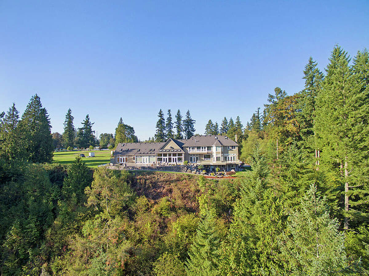 The lodge-style home sits on 5 landscaped acres. It's listed for $1.899 million.