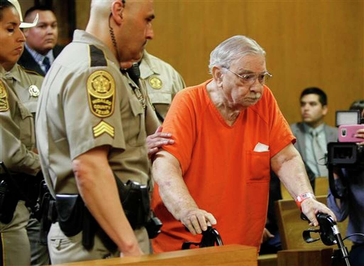 John Feit is lead into the 92nd State District Court for his arraignment Monday March 14, 2016, at the Hidalgo County Courthouse in Edinburg, Texas. Feit is accused of murdering Irene Garza, a teacher and ex-beauty queen, when he was a priest in 1960.